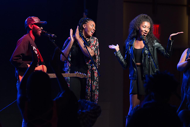 Jordan Williams, the 2016 Pan Afrikan Week King, performs a song with help from his back up singers at Talley Ballroom for the 2016 Pan Afrikan Week Benefit Concert on April 8, 2016.  The concert, which featured inspiring local artists, was held in an effort to raise awareness of suicide prevention, crisis intervention, and to stand in solidarity with R&B and hip hop singer-songwriter Kehlani, who had to cancel her performance earlier in the week.