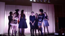 All of the Intermediate & Beyond Designers stand on the stage during the naming of the winner of the African American Textile Society Fashion Expose, Thursday Evening, April 7, 2016. This was the 19th annual show and 16 designers participated in the show this year.
