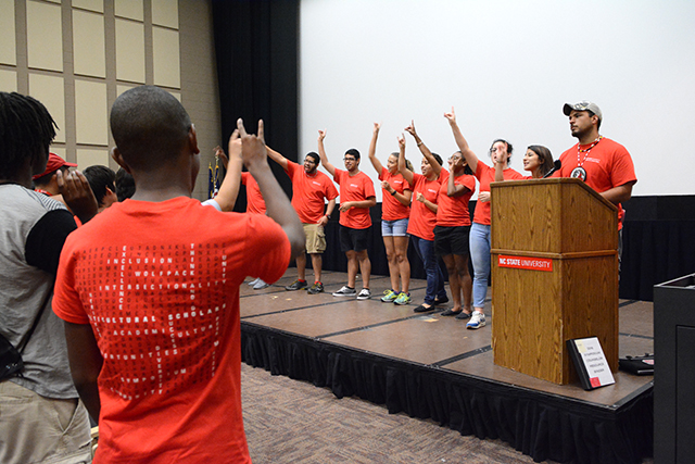 Multicultural Scholars students hold up the Wolfie while learning the Red and White song with the counselors during the 2016 Symposium for Multicultural Scholars at Witherspoon Cinema Friday, Aug. 12.  The symposium is a summer educational and transitional experience sponsored by the Office of Multicultural Student Affairs as well as the Offices of Native American, African American and Latino Student Affairs.  The purpose of the symposium was to foster a sense of community for incoming first-year students and provide them with information on campus resources.