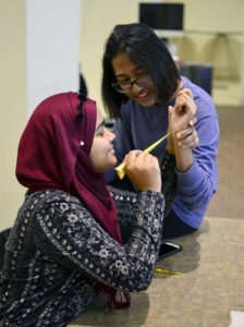 Student receives henna tattoo