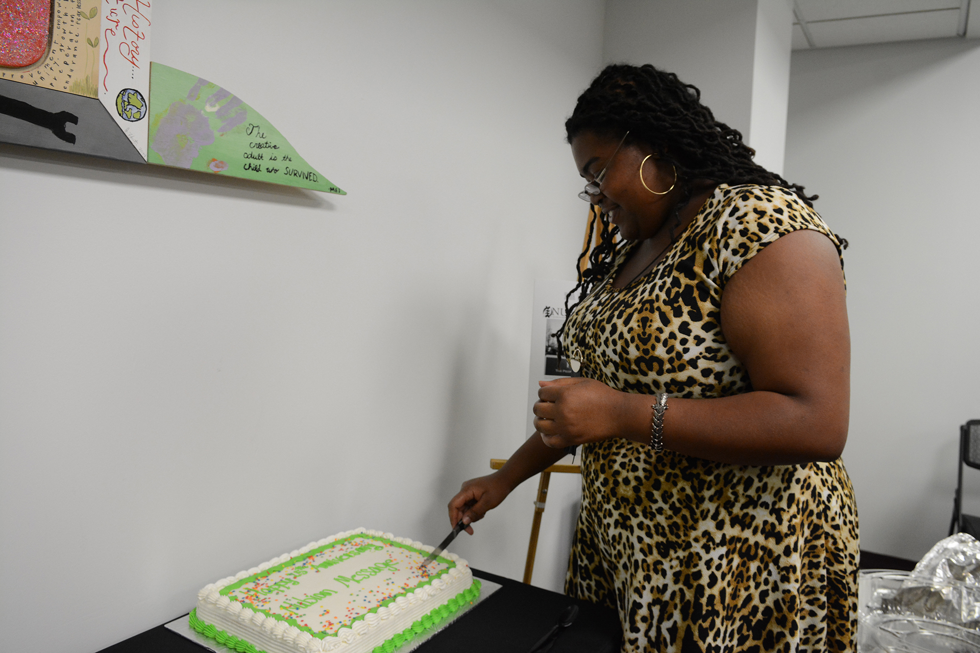 woman cutting birthday cake