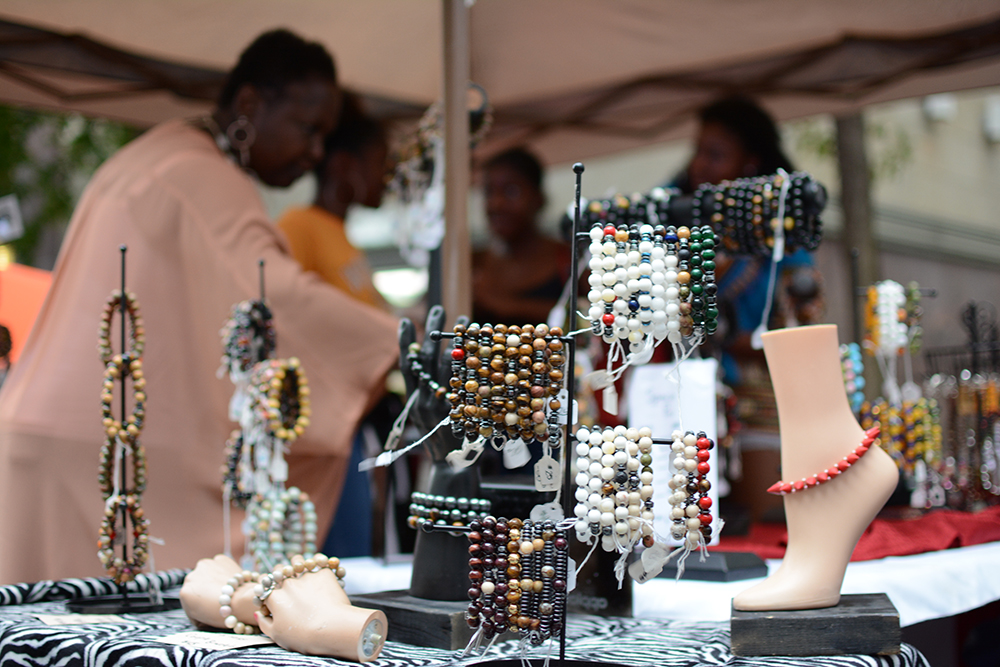The handmade jewelry by Sadarryle Rhone stands on display for visitors during the African American Culture Festival of Raleigh and Wake County on Saturday, Sept. 1, 2018. (Shanmukha Sandesh/Staff Photographer)