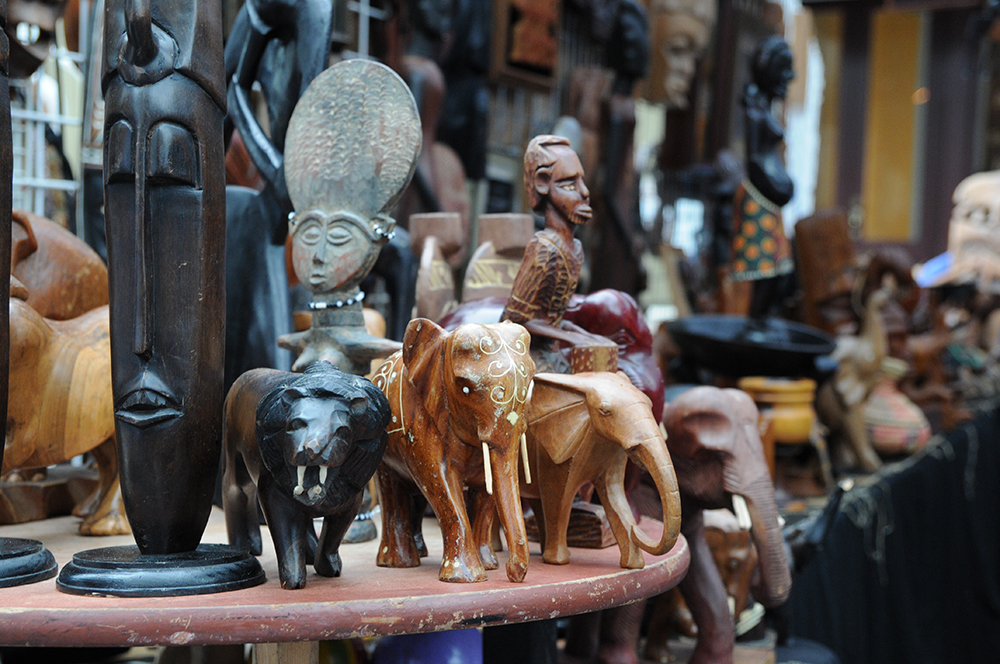 Traditional African wood carvings stand on display in front of a vendor tent at the African American Cultural Festival of Raleigh and Wake County on Saturday, Sept. 1, 2018. The festival celebrated African American music, art, and culture with many blocks of vendors and three stages set up along Fayetteville Street. At the festival, vendors sell anything from food to highly unique art. (Glenn Wagstaff/Staff Photographer)