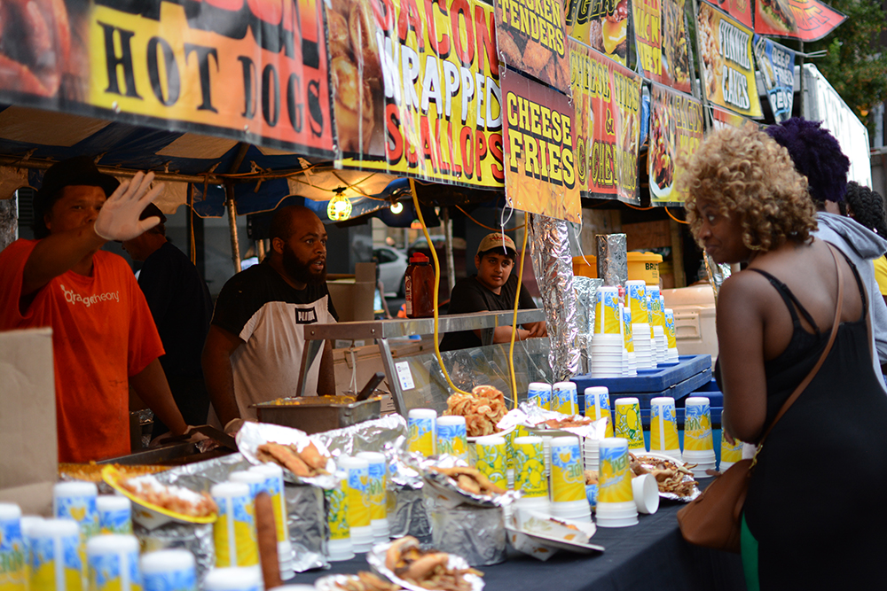 Visitors check out the fresh, hot and crispy food during the African American Culture Festival of Raleigh and Wake County on Saturday, Sept. 1, 2018. (Shanmukha Sandesh/Staff Photographer)