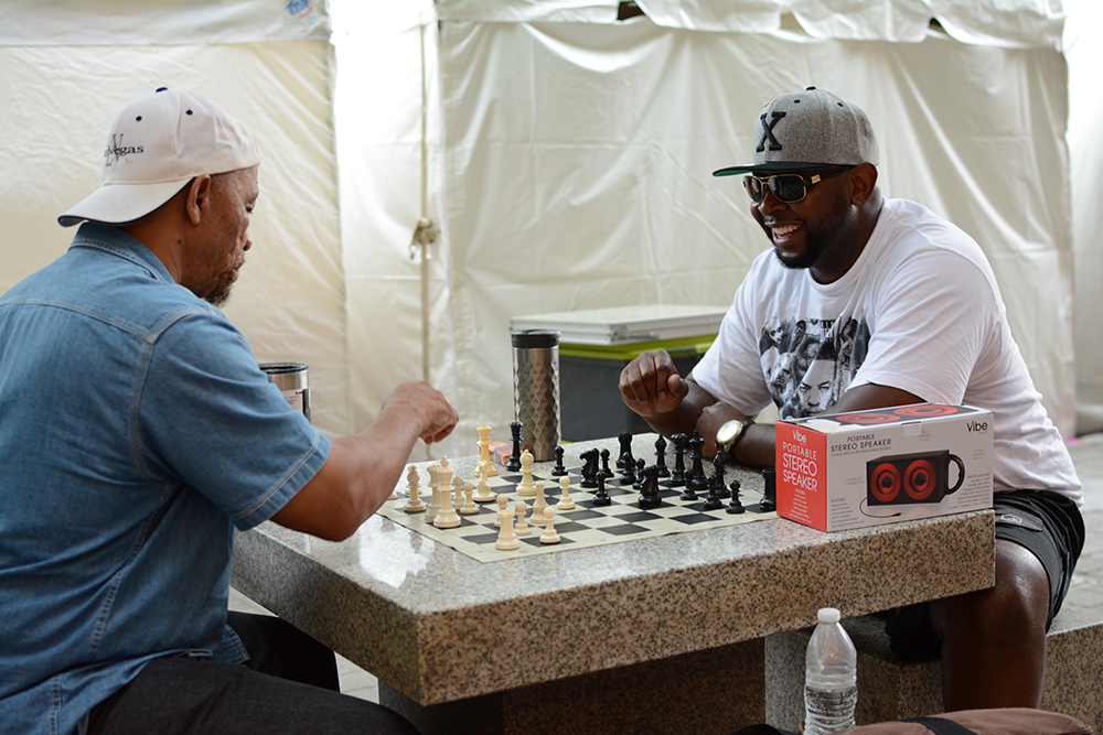 Visitors have fun and relax themselves by playing chess during the African American Culture Festival of Raleigh and Wake County on Saturday, Sept. 1, 2018. (Shanmukha Sandesh/Staff Photographer)