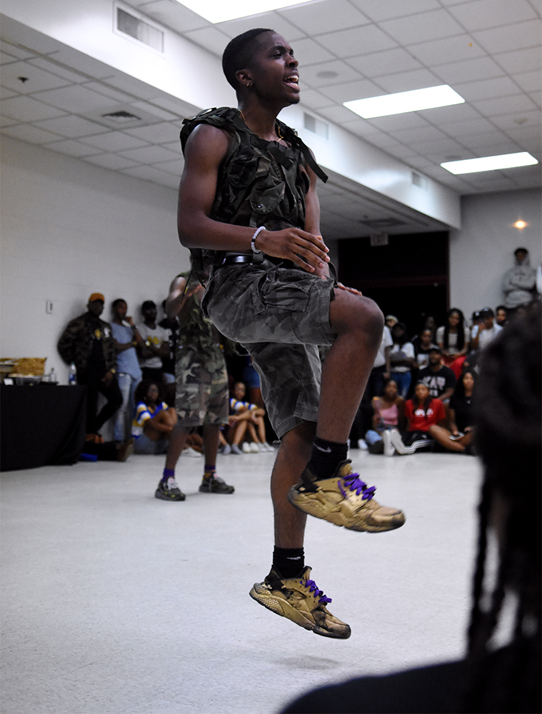 Trea Johnson, a brother of the Kappa Lambda chapter of Omega Psi Phi Fraternity, Inc. strolls during the Back 2 School Jam in the Washington-Sankofa Room on Wednesday, Aug. 22.