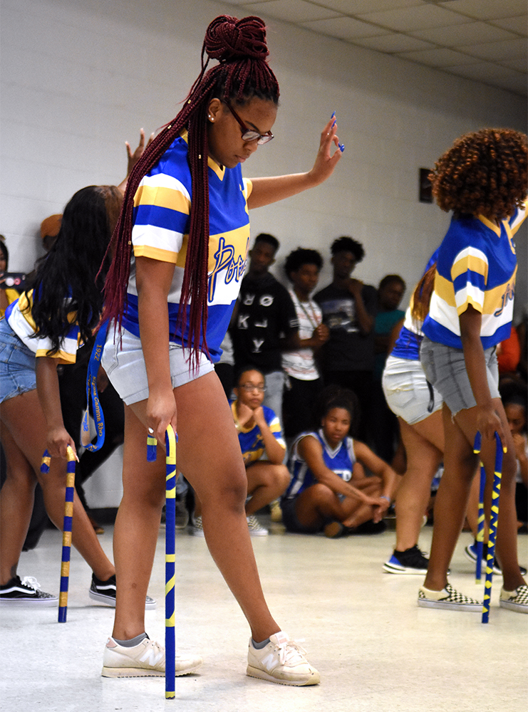 Sisters of the Kappa Omega chapter of Sigma Gamma Rho Sorority Inc. perform a step routine during Back 2 School Jam, Wednesday, Aug. 22, in the Washington-Sankofa Room. Typically, the event is held outdoors on Harris Field, but was moved inside due to rain.