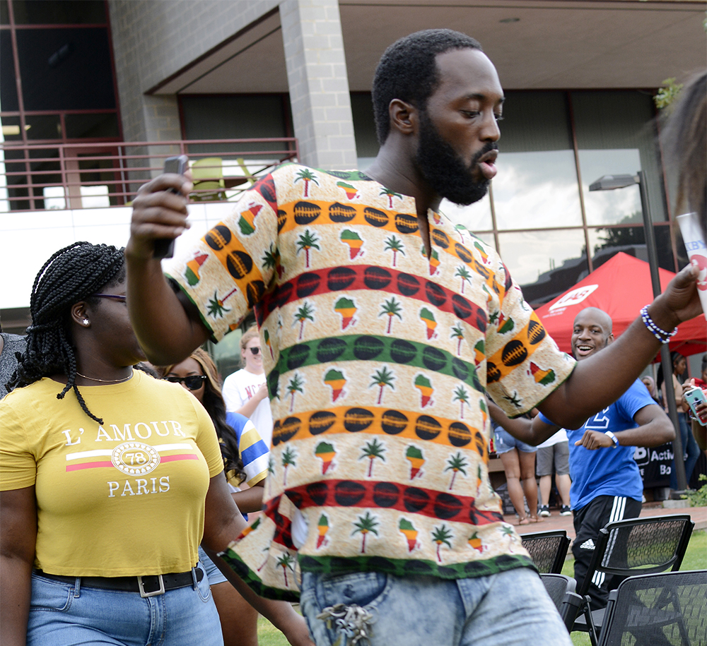 NC State alumnus Jeeda Barrington dances while playing musical chairs at Back 2 School Jam. The event, which took place after the first day of classes, allows students the chance to learn more about campus organizations. The event also includes performances, games, and food.