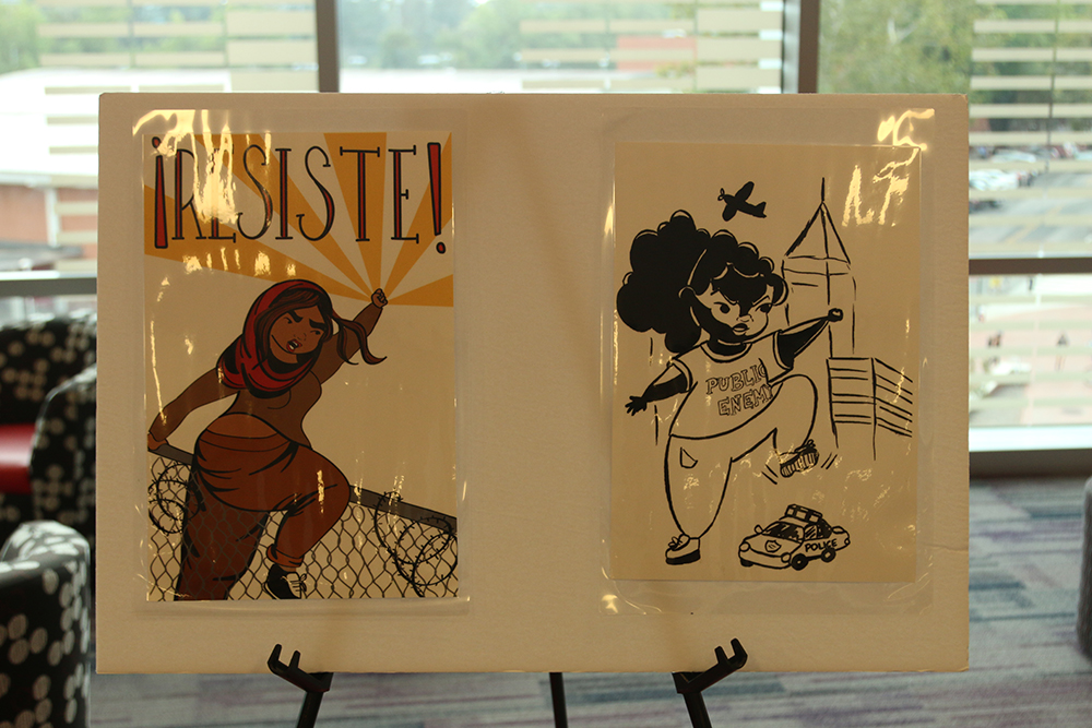 """Art by Q Wideman on display at """"My Art is Resistance"""" on October 9, 2018 in Talley Student Union. The paintings reflected social justice and women's empowerment. (Shanmukha Sandesh/Staff Photographer)"""
