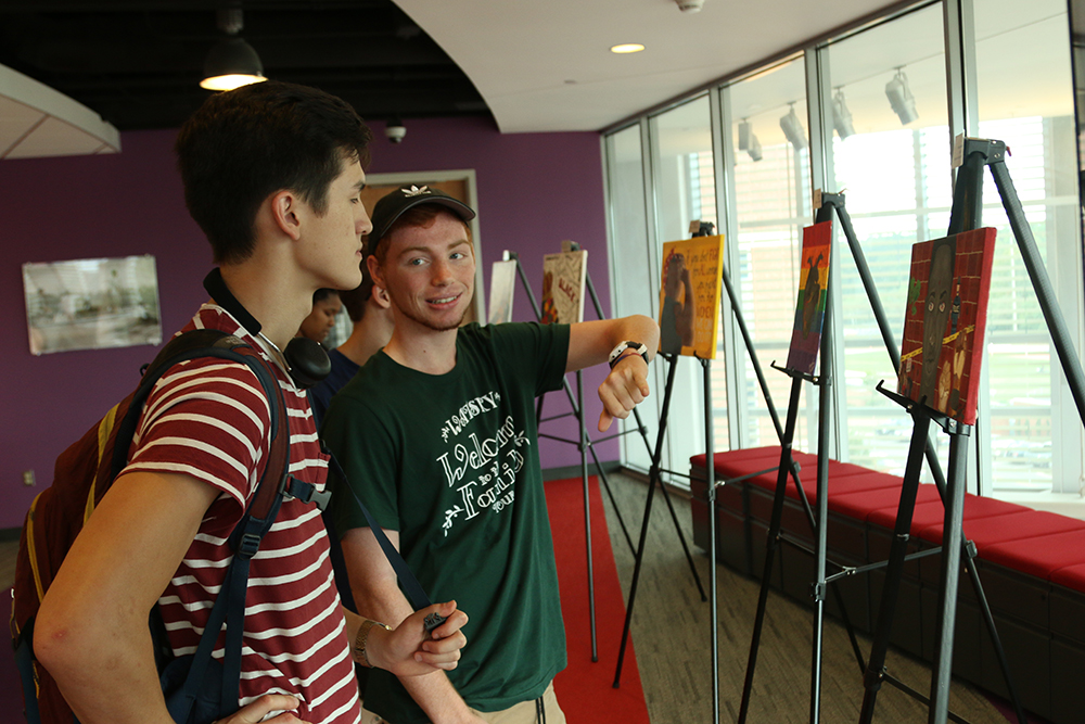 Ben and Parker were exploring the paintings at My Art is Resistance  on October 9, 2018 in Talley Student Union. (Shanmukha Sandesh/Staff Photographer)