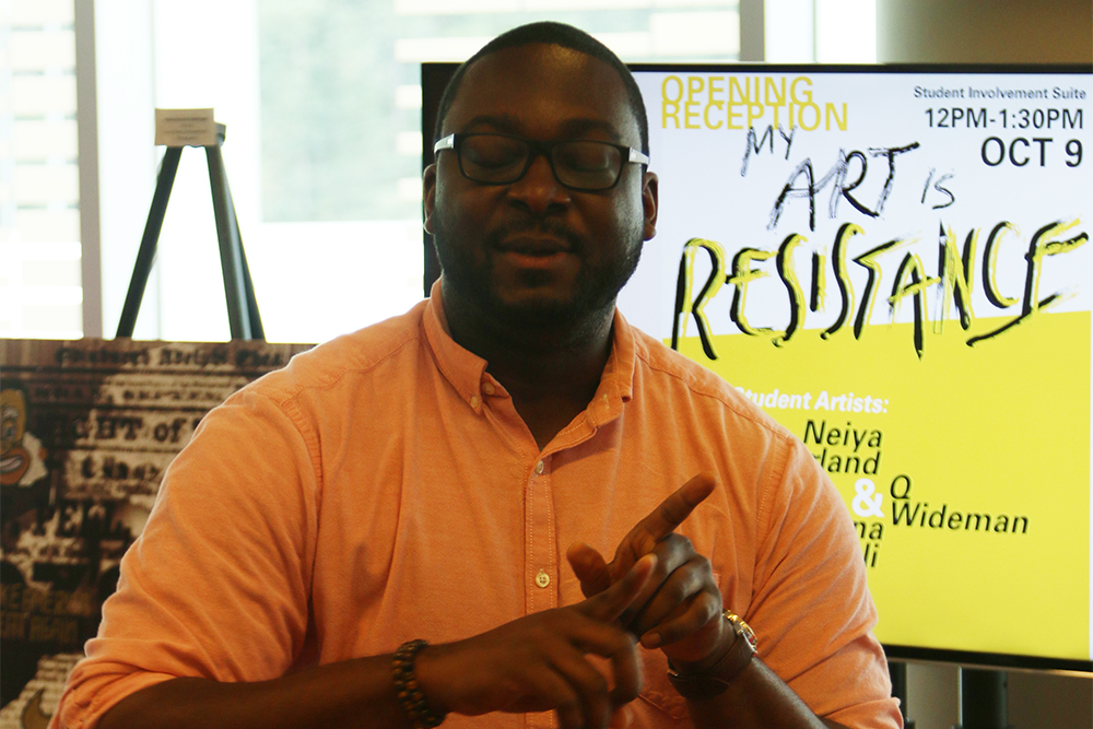 """GLBT Assistant Director Preston Keith introduces exhibition artists at """"My Art is Resistance"""" on October 9, 2018 in Talley Student Union. (Shanmukha Sandesh/Staff Photographer)"""