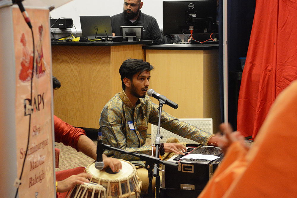 Love Dhameliya, a student at Wake Technical Community College, plays the harmonium during the BAPS Diwali event in Riddick Hall on Friday, November 2, 2018. BAPS, a branch of Hinduism, hosts the event with its campus fellowships from North Carolina colleges and universities. The event has taken place at NC State for the past four years. (Amrita Malur/Staff Photographer)