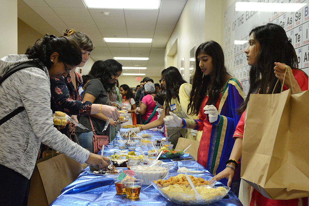 Attendees of the BAPS Diwali celebration receive food and blessed offerings on Friday, November 2, 2018 in Riddick Hall. Diwali, or the festival of lights, is considered the new year for Hindus. BAPS is branch of Hinduism and together with their temple and campus fellowships across North Carolina host the event annually. (Amrita Malur/Staff Photographer)