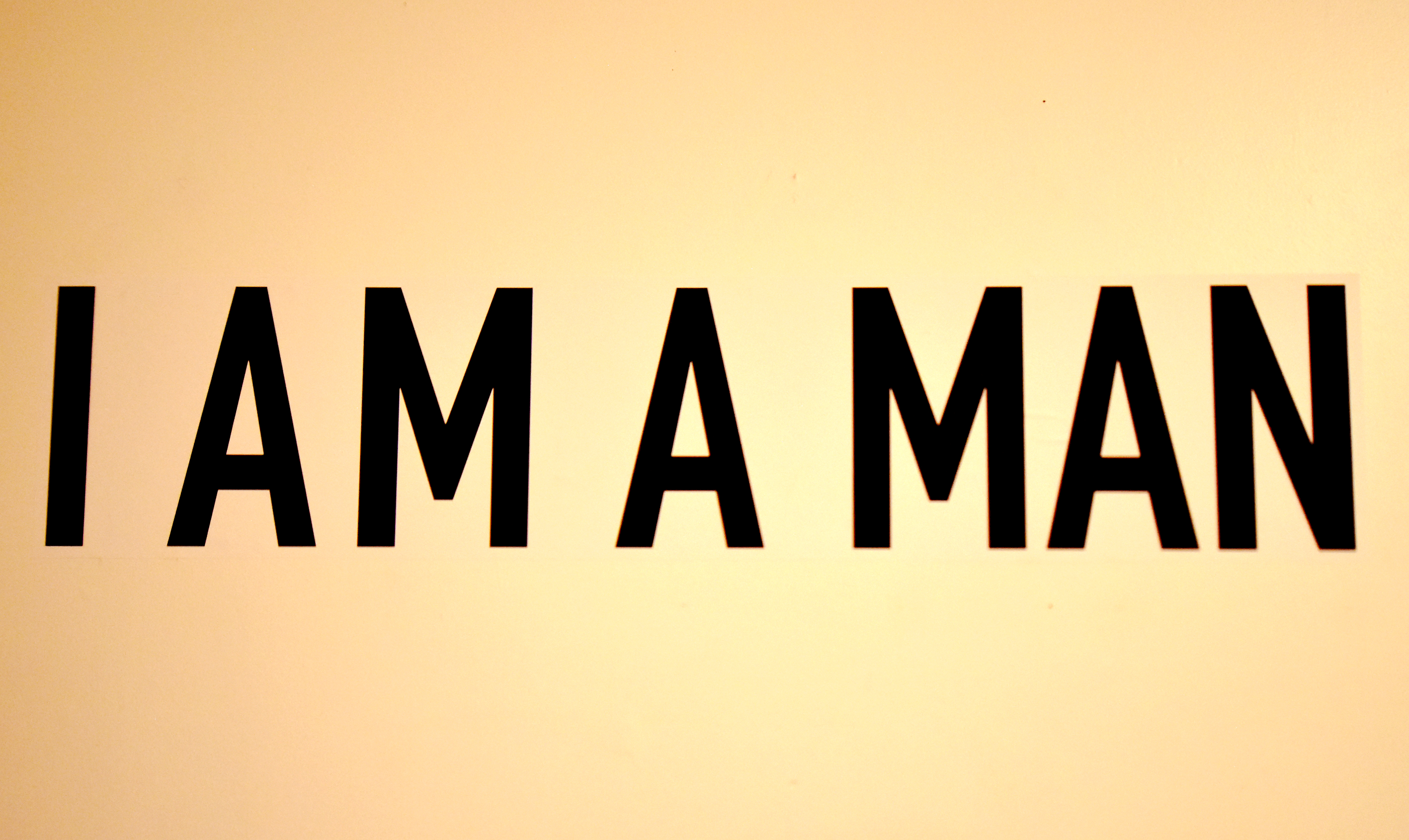 "The phrase ""I AM A MAN"" is written on the wall at the ""I Am A Man"" exhibit."