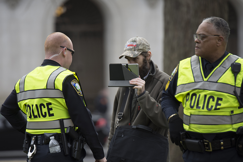 A counter-protester was escorted out of the event after disrupting the event at the Crush Confederates at the Capital event on Saturday, Feb. 9 at the North Carolina State Capitol in Raleigh. (Kaydee Gawlik/Nubian Message)