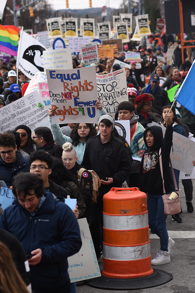 Marchers make their way down South Street during Moral March on Raleigh on Saturday, Feb. 9, 2019.