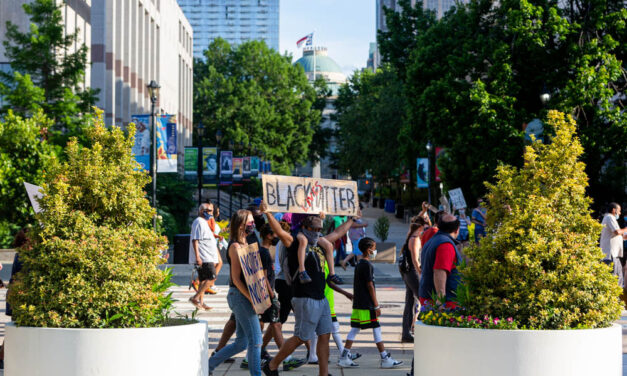 Raleigh Community Gathers To Speak Out Against Injustices