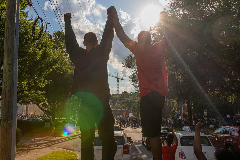 Protestors On Car